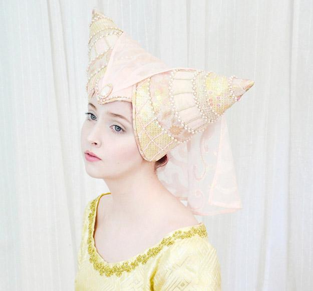 angela wears a handcrafted horned head dress