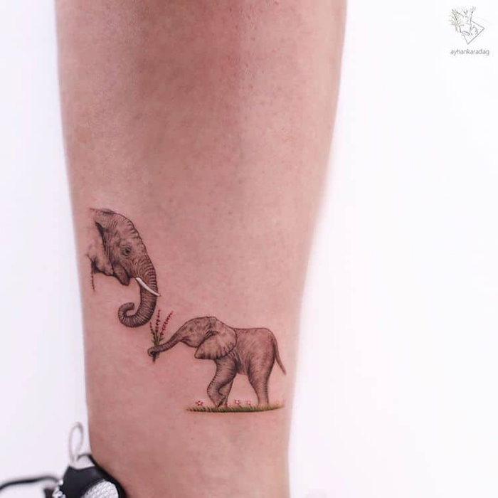 baby elephant presents a bouquet of wild flowers to his mom cute tattoos