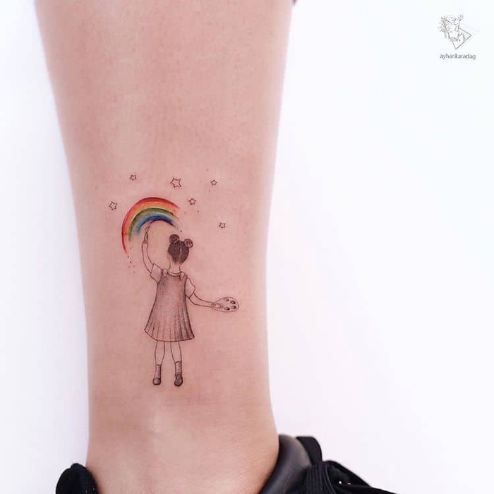 girl paints rainbow