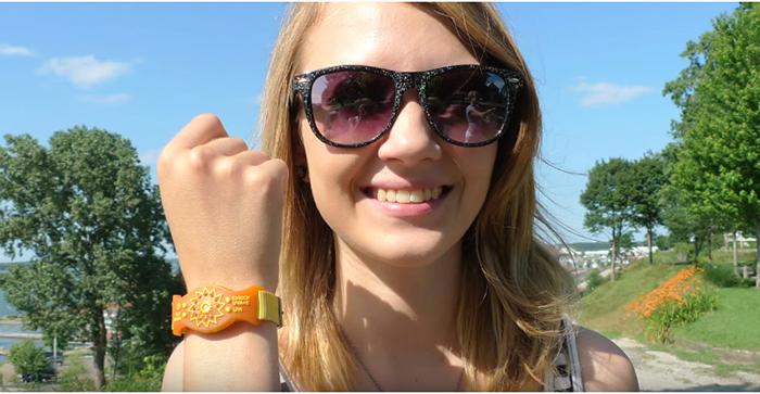 girl wearing ultraviolet measuring gadget