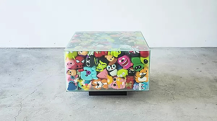 glass cube furniture filled with squishy toys