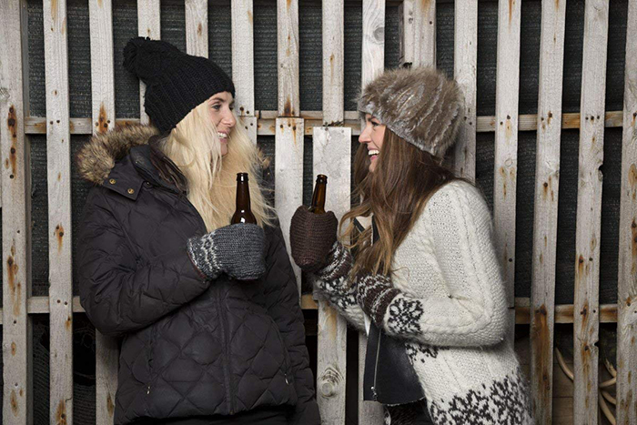 knitted hand gloves designed to hold beer