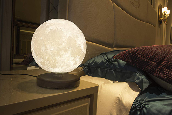 levitating moon lamp in bedside table