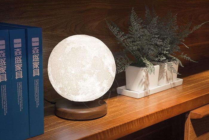 levitating moon lamp in book shelf