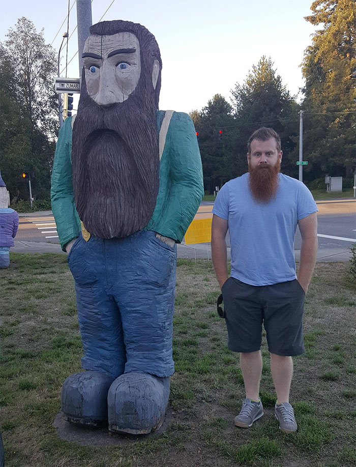 lookalikes unexpected places giant wooden statue