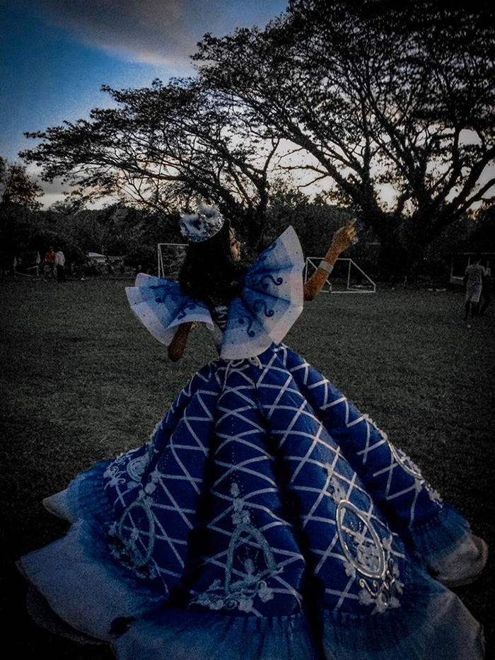 maverick oyao creates blue gown for sister