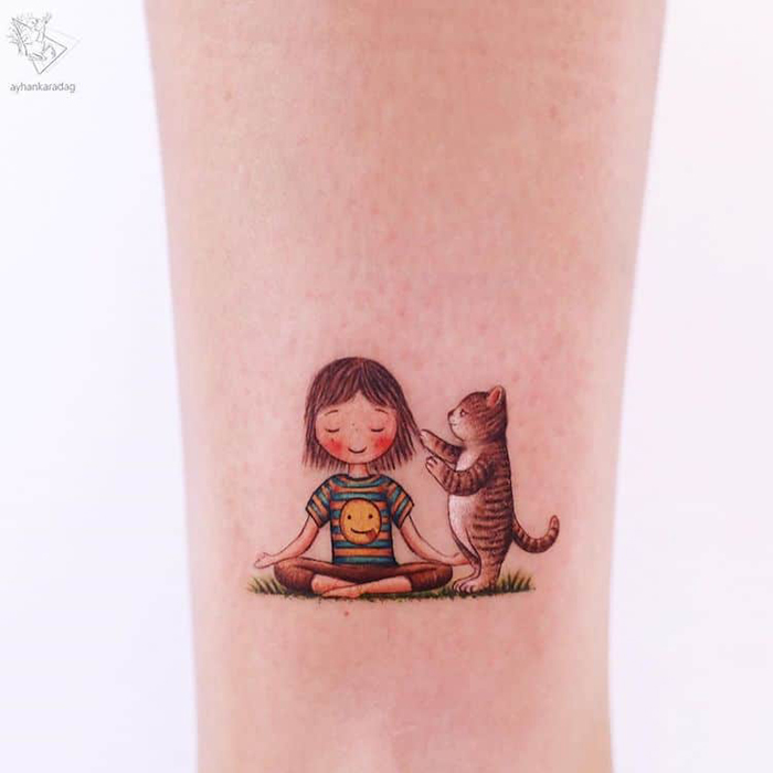meditating girl supported by cat tattoo