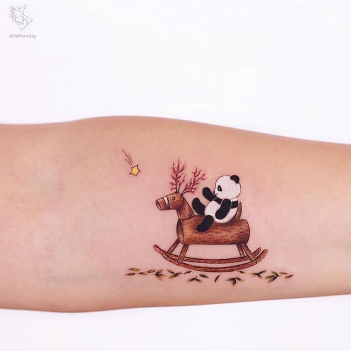 panda on a rocking horse tattoo