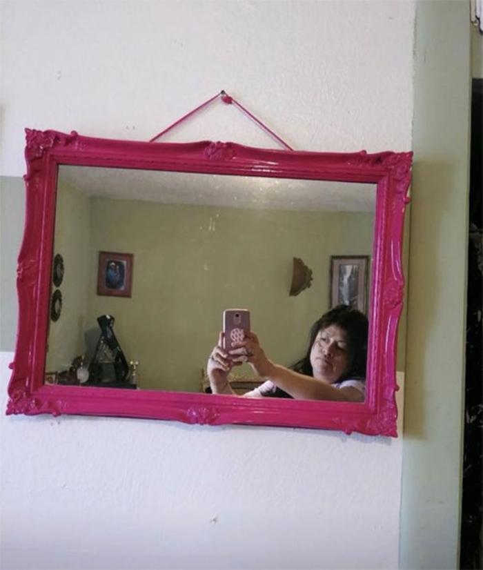 people trying to sell mirrors pink frame