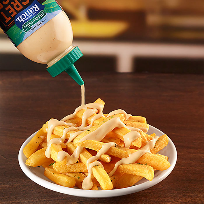 secret sauce drizzled over fries