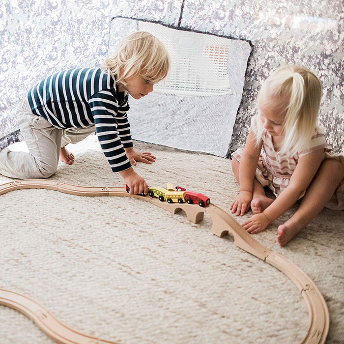 2 Kids Playing with Toy Trains