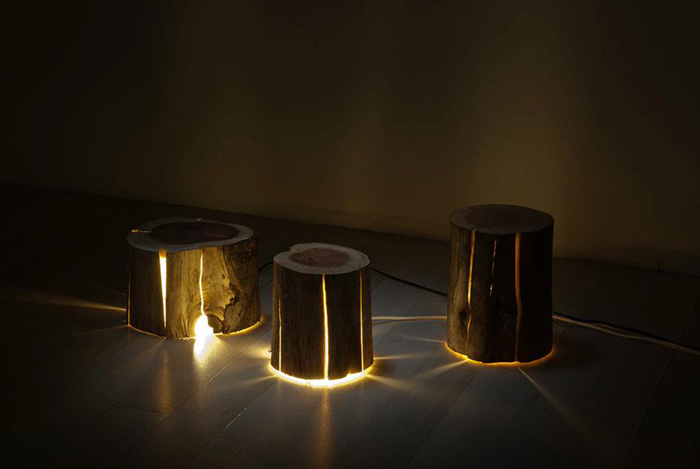 3 Lighted Wooden Lamps on Floor