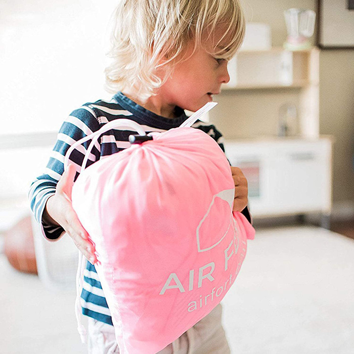Boy Carrying Air Fort Bag