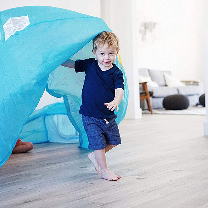 Boy Coming Out of Inflatable Play Tent