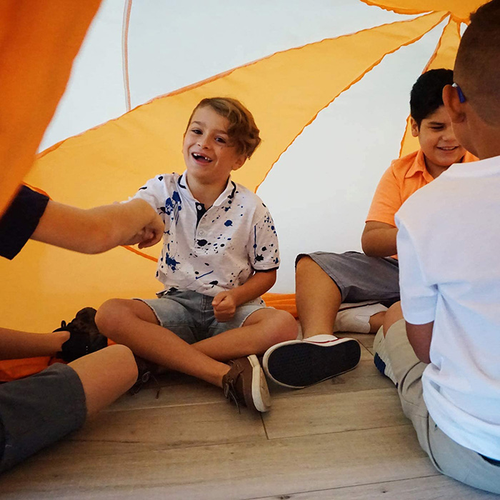 Boys Playing Inside Inflatable Play Tent