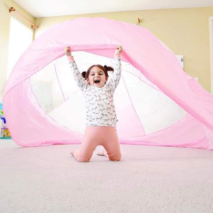 Girl Playing with Inflatable Play Tent