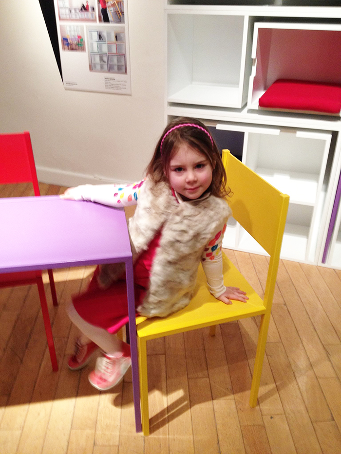 Girl Sitting on Yellow Chair