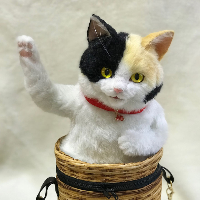 Lifelike Cat Plush Toy in a Bag with Movable Paws