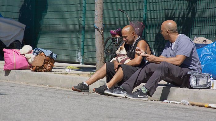 Street Veterinarian Dr. Kwane Stewart Listening to a Homeless Man's Story