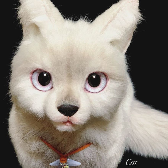 White Feline Stuffed Toy Facial Features