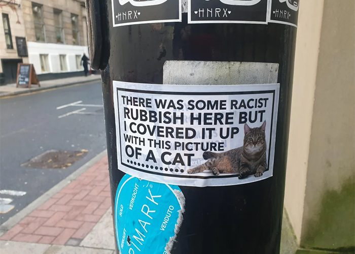 cat stickers cover up racist graffiti