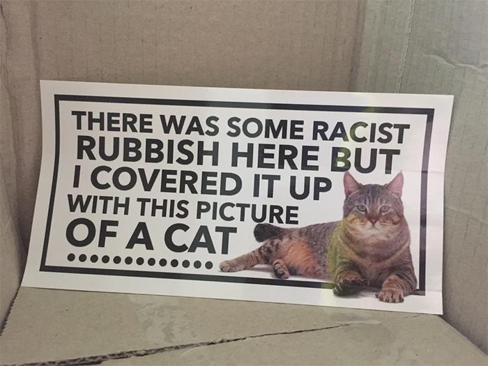 cover up sticker for racist propaganda
