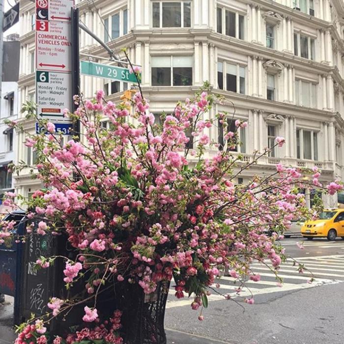 floral arrangement lewis miller trash can broadway