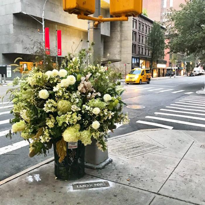 floral arrangement lewis miller trash can flower vase