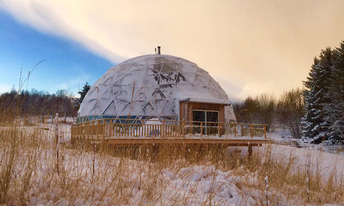the geodesic dome protects the cob house from heavy snowfall
