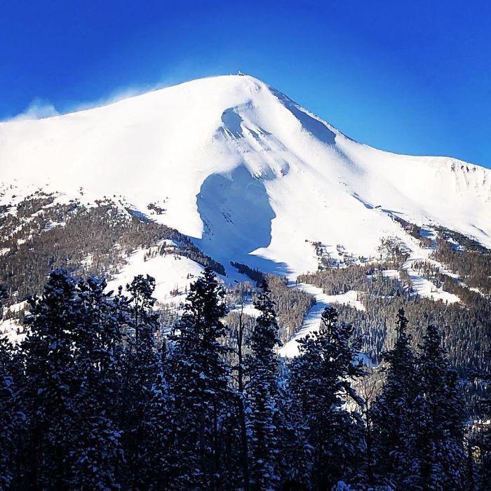 two men's silhouettes on lone peak, montana pareidolia