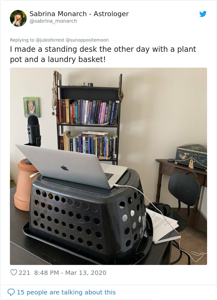 working from home unglamorous workspace laundry basket desk