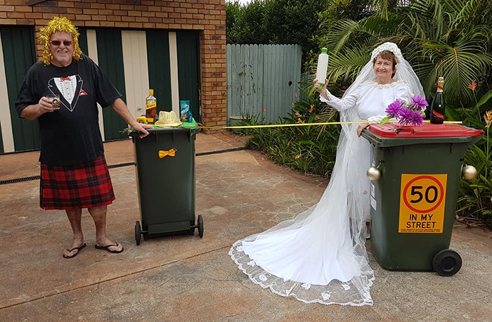 Bin Isolation Outing Couple in Wedding Outfits Taking Bin Out