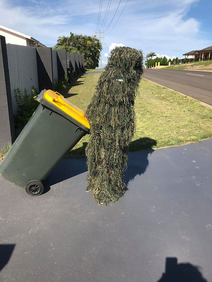 Bin Isolation Outing Person in Ghillie Suit Taking Bin Out