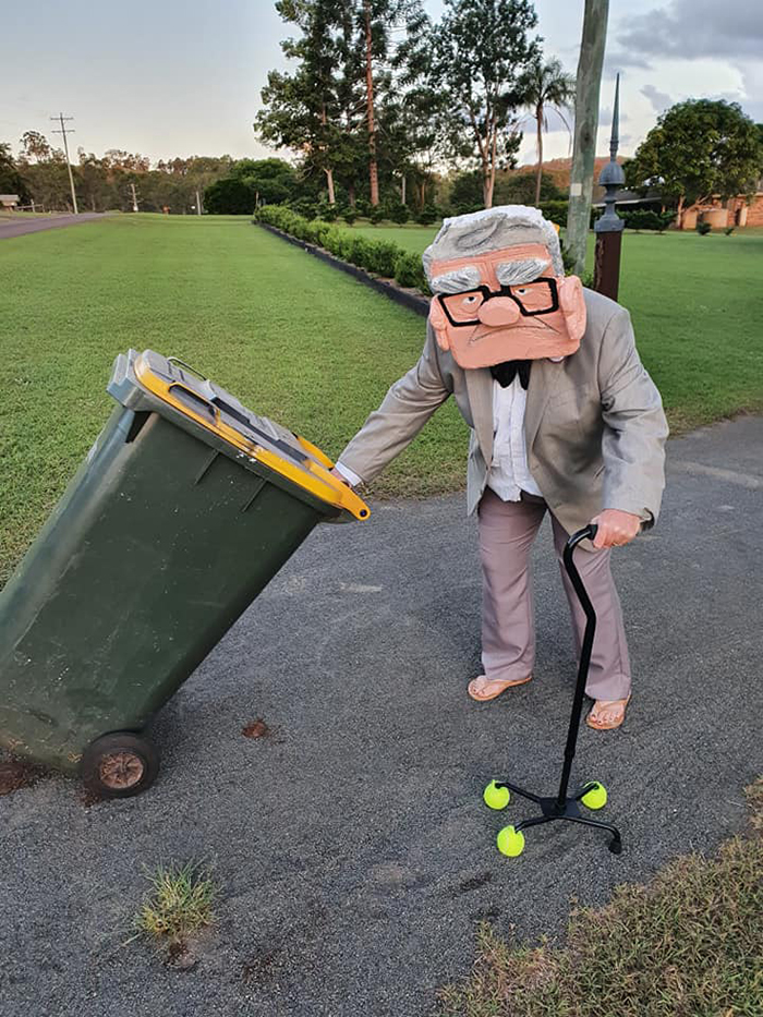 Bin Isolation Outing Woman in Carl Fredricksen Outfit Taking Bin Out