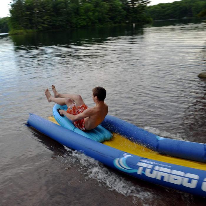 Boy Sliding on Turbo Chute by the Lake