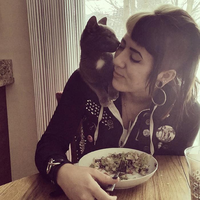 Kitten Sitting on Woman's Shoulder