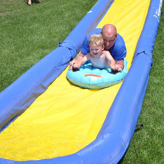 Father and Son Sliding on Turbo Chute at Backyard
