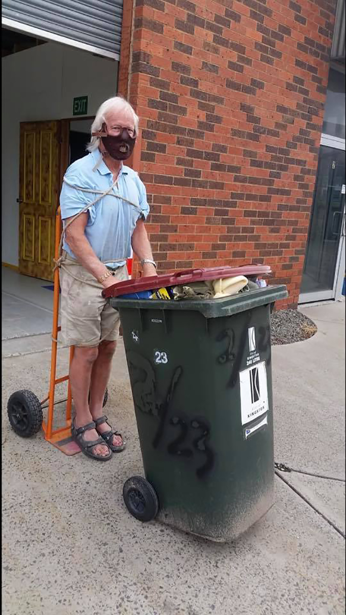 Man Dressed as Hannibal Lecter Taking Trash Out