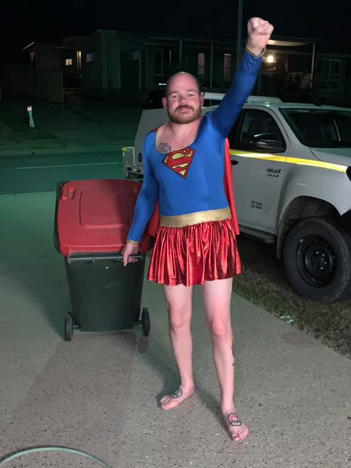 Man Dressed as Supergirl Taking Trash Out