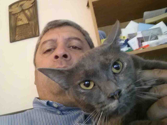 Man Taking Selfie with Cat