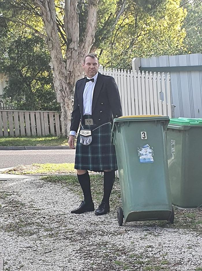 Man in Kilt Taking Trash Out
