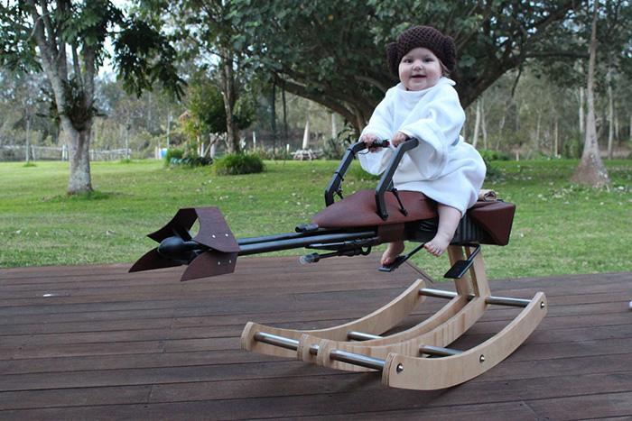 One-year-old Girl Sitting on Rocking Speeder Bike