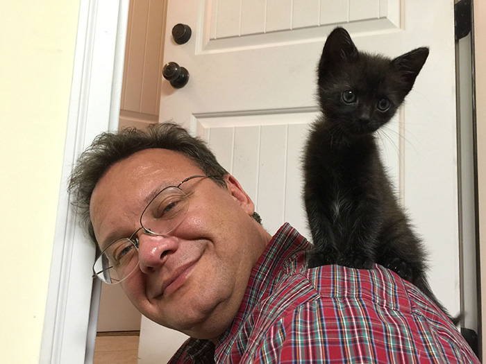 People Who Didn't Want Cats Girlfriend's Father with Cat on Shoulder