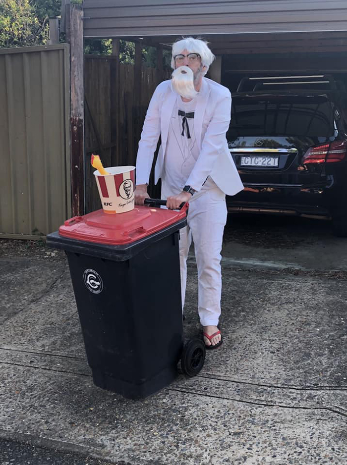 Person Dressed as Colonel Sanders Taking Trash Out