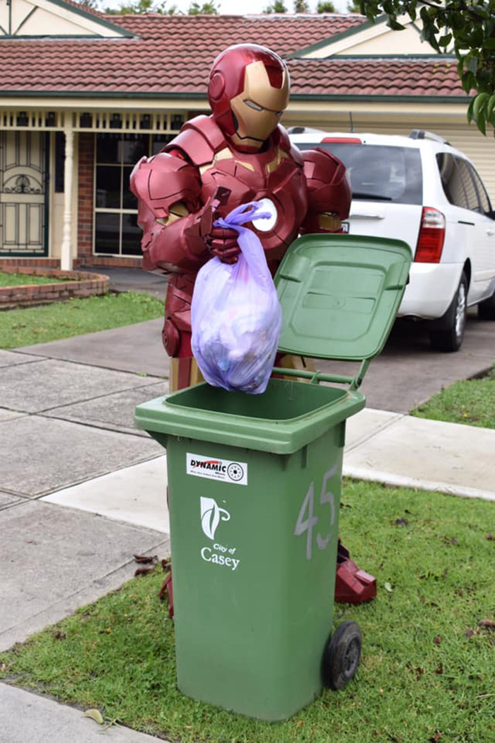 Person Dressed as Iron Man Taking Trash Out