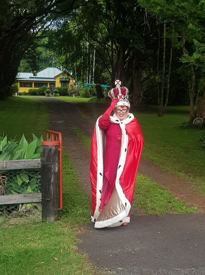 Woman Dressed as Queen Taking Trash Out