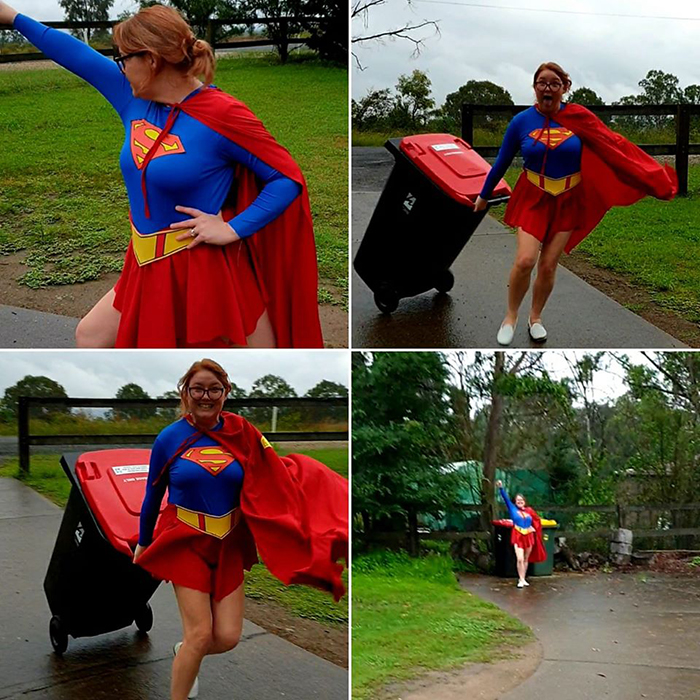 Woman Dressed as Supergirl Taking Trash Out