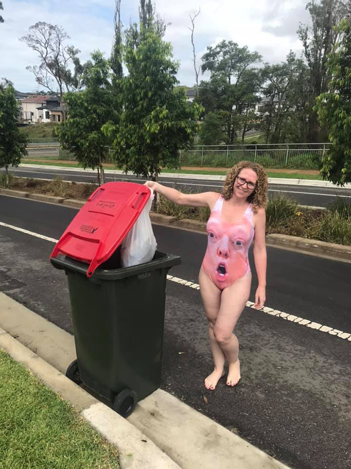 Woman in Trump Swimsuit Taking Trash Out