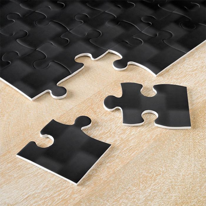 all-black jigsaw pieces