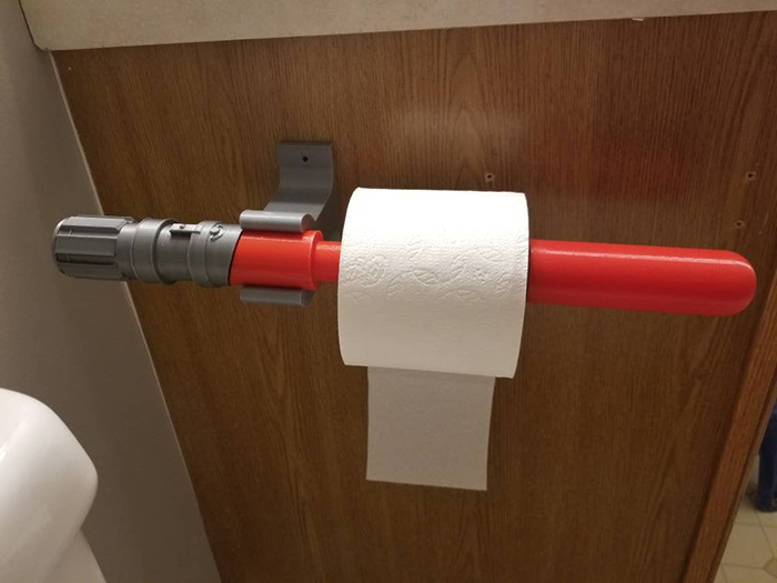 lightsaber mounted toilet paper holder red